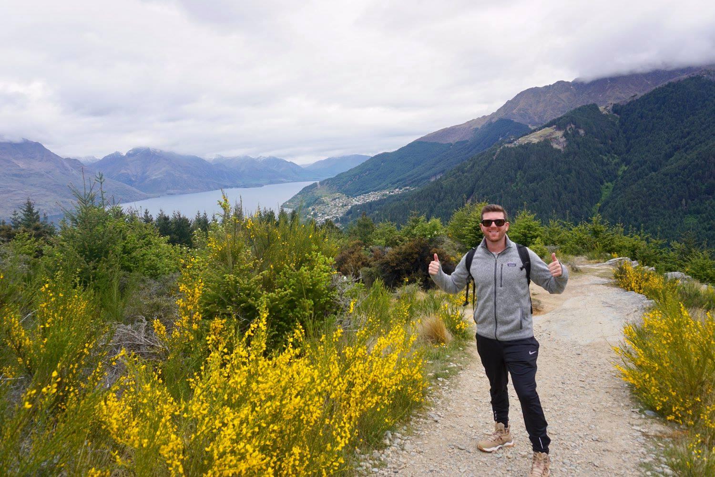 Adam on the Queenstown Hill Hike overlooking Lake Wakatipu