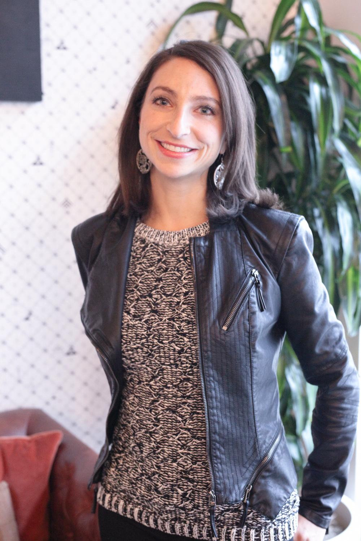 Rebecca Otis Leder smiles in her leather jacket.