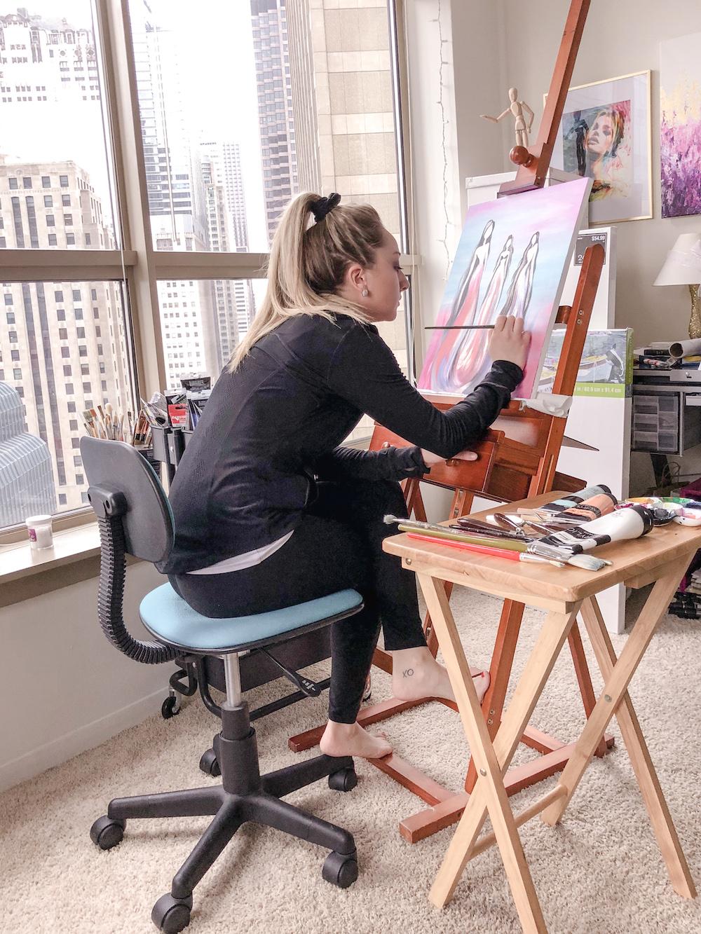 Amanda painting while sitting