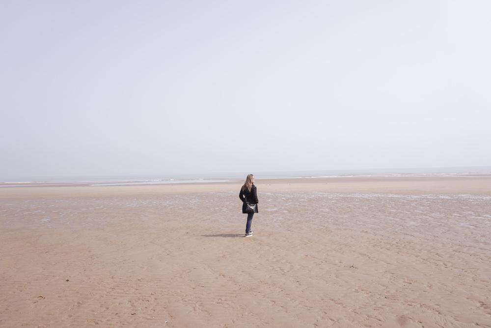 Kelly walks along Omaha Beach in Normandy, France.