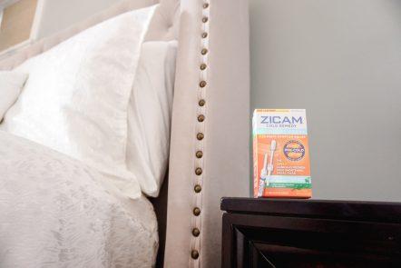 Zicam sits on a nightstand in a bedroom.