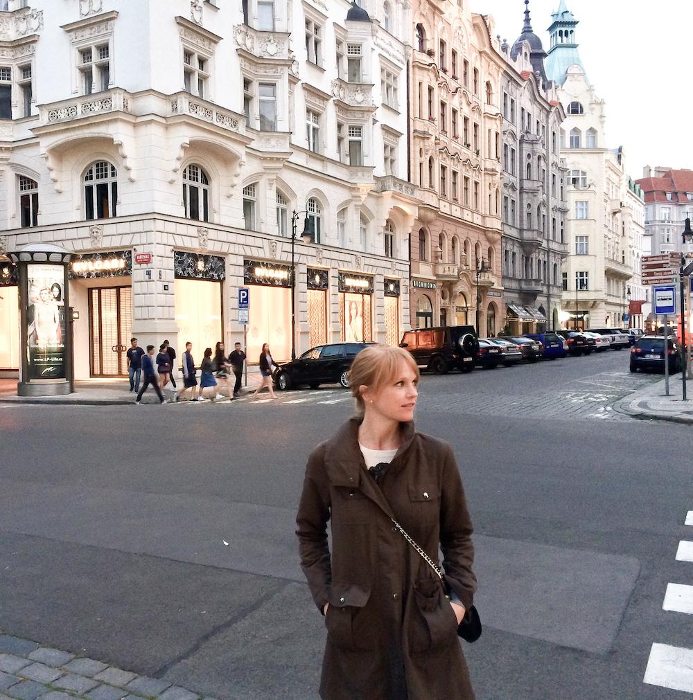 Margot Craig stands in a European city.